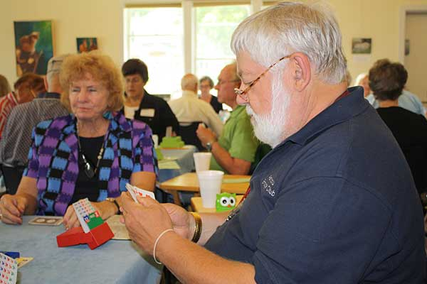 EHSAA president Mike Povich sits in deep concentration during a weekly bridge game at the Northeast Harbor Library, which is held every Tuesday afternoon during the summer. The Asticou/Island Division is a part of the Ellsworth Duplicate Bridge Club, which meets year-round.